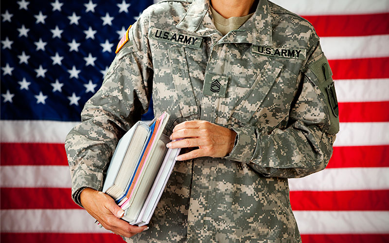 US Army Veteran Holding Books